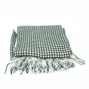 Grey and white checkered blanket.