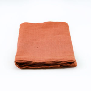Terracotta napkins with elegant stitched border.