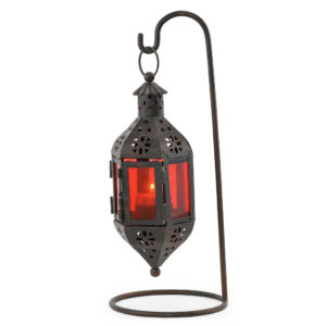 Black iron with red glass Moroccan lantern on stand.