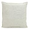 Beige textured cushion.