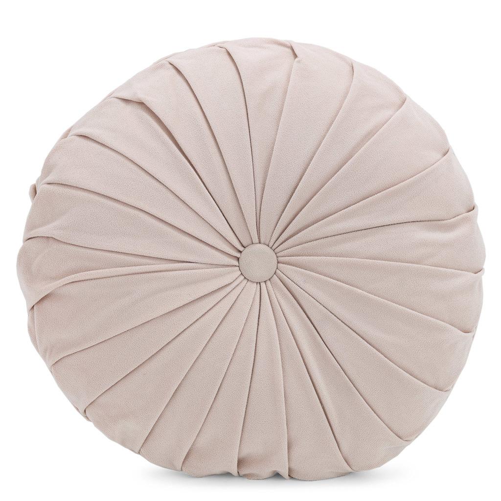 Pale pink round cushion.