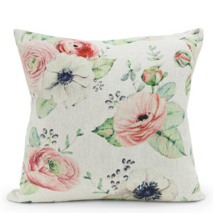 Cream, pink and green floral patterned cushion.