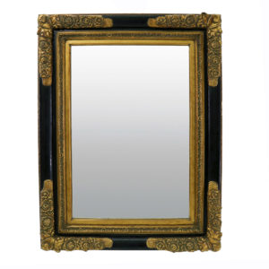 Large vintage mirror in black and gold frame.
