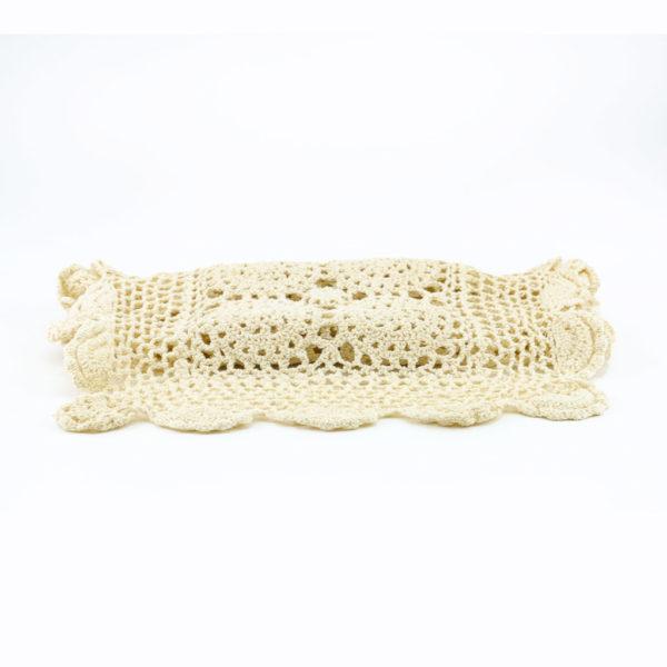 Beige crochet table runner.