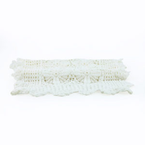 White crochet table runner.