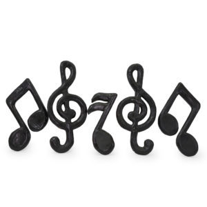 Black paper mache music notes. Assorted designs. 8 in stock.