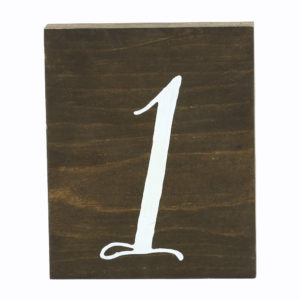 Timber table numbers with white elegant writing. 1 to 35.