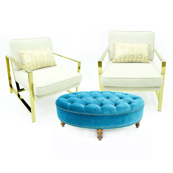 Blue ottoman with two godl and white arm chairs. Add a stylish and spectacular seating option to your event.