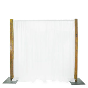 Black fairylight backdrop with timber posts.