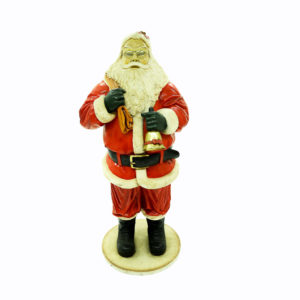 Large Santa statue holding bell.