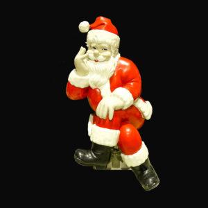 Large Santa statue sitting on present cross-legged.