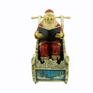 "Large Santa in Sleigh. Santa is leaning back ready a book saying ""T'was the night before Christmas....""."