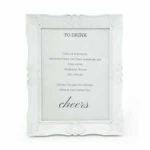 White vintage frame used to display drinks on offer.