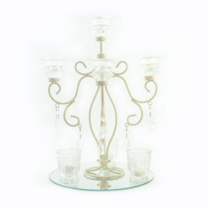 Ivory candelabra & crystal centrepiece.