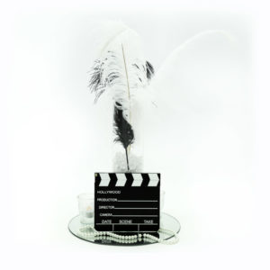 Hollywood glam centrepiece, complete with movie clapper boards, feathers, pearls and a whole lot of pizzaz!