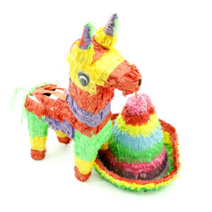 Colourful Mexican style pinyatas. Donkey and Hat.