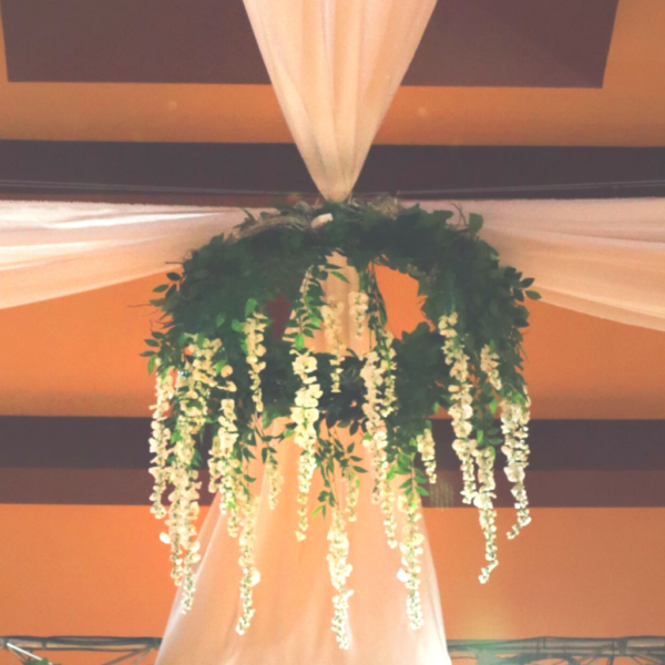 Faux ivory/timber chandelier wreath.