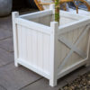White timber planter box.