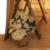 Faux white florals in wicker basket.