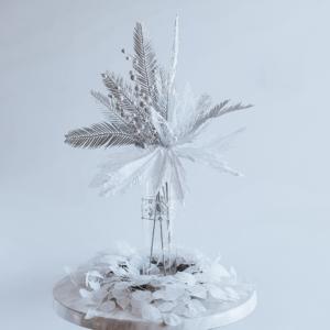 Elegant silver leaf Christmas centrepiece.