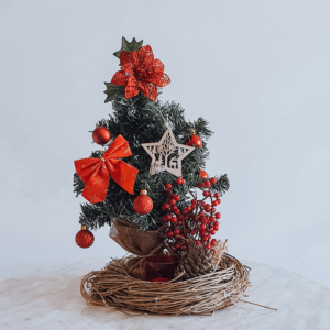Red Christmas tree in a nest style wreath - Christmas centrepiece.