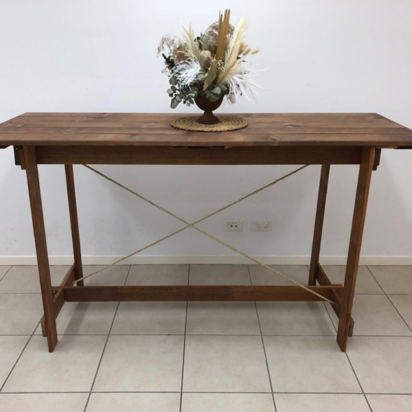 A beautiful rustic timber and rope high dry bar table. No need for a tablecloth with this stylish timber table as the exposed timber is a stunning feature.   110cm high x 60cm wide x 195cm long.